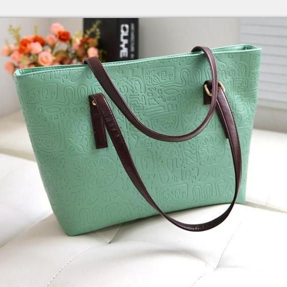 The new European and American fashion candy colored handbag Ms. shoulder portable package Oracle